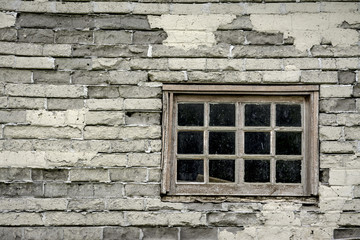 Very old window in the side of a farm house
