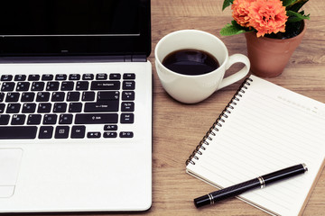 Laptop and cup of coffee with flower on desk, Vintage style