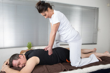 One man and woman performing back  massage