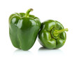 Close-up shot of two green bell peppers isolated on white - 79277100