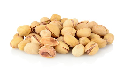 Studio shot of group of pistachios isolated on white background