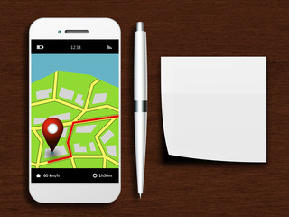 mobile phone with gps application, pen and clean note lying on d