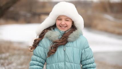 girls in white fluffy hat smiling