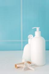 Skincare items on blue tile background, soft focus