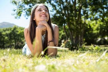 Pretty brunette lying on the grass