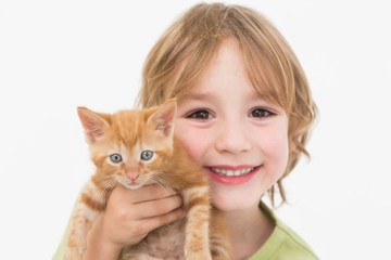 Close-up portrait of cute boy holding kitten