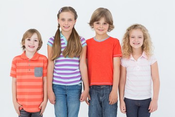Children standing side by side on white background