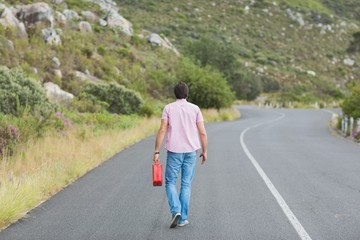 Man walking away holding petrolcan