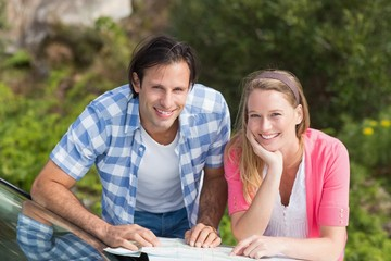 Smiling couple looking at a map