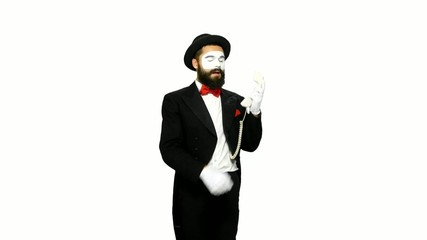 Man mime hears the ring of telephone and answers on white