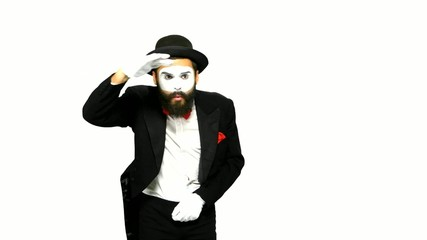 Man mime looks for something and uses binoculars on white