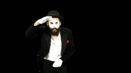 Man mime looks for something and uses binoculars, alpha channel