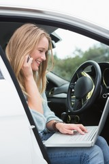 Young woman working in the drivers seat