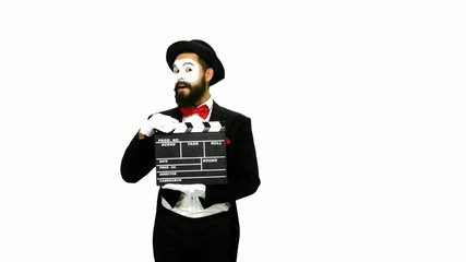 Man mime sneezes using the movie clapper on white background