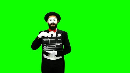 Man mime sneezes using the movie clapper on green screen