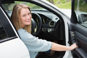Young woman in the drivers seat