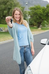 Young woman holding her key