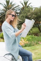 Young woman reading a map