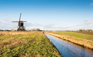 Dutch polder mill against a blue sky