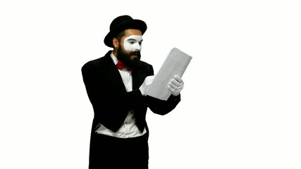 Happy man mime reads about something on paper, white background