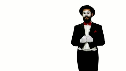 Man mime talks to somebody on white background