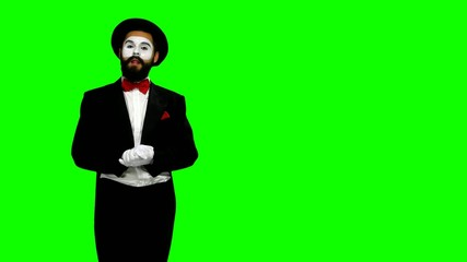 Man mime shows something in air on green screen