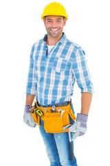 Portrait of smiling handyman wearing tool belt