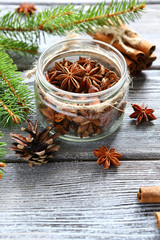Aromatic anise and cinnamon with pine branches on the boards