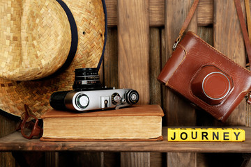 Set of tourist with word Journey on wooden planks background