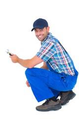 Portrait of happy handyman holding wrench