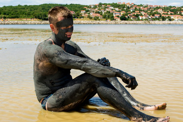 Man applying healing clay