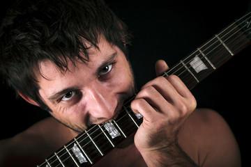Man eat a guitar