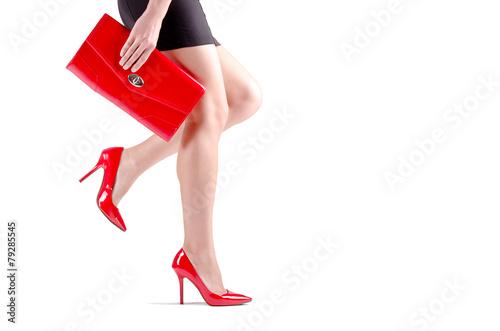 Beautiful walking female legs in red shoes - 79285545