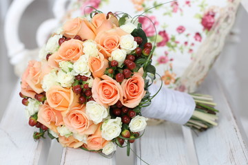 wedding bouquet of roses on a wooden bench