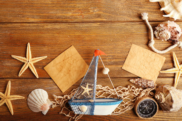 Beautiful sea composition with boat and shells