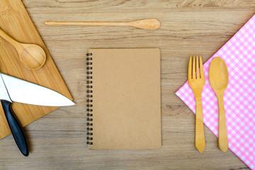 Kitchen utensil with notebook