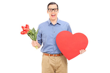 Excited guy holding red heart and bunch of flowers