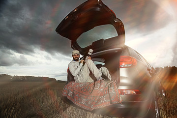 traveler in a jeep sky clouds autumn
