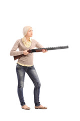 Furious woman holding a shotgun