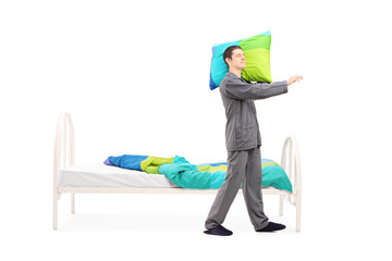 Young man in pajamas sleepwalking