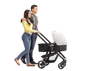 Young parents pushing a baby stroller