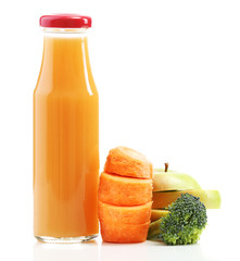 Glass bottle of fresh healthy juice with sliced carrot, apple