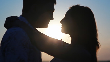 young couple love kissing at sunset