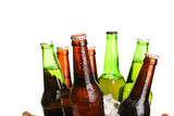 Glass bottles of beer in metal bucket isolated on white