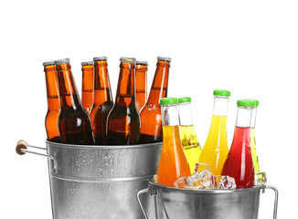 Glassware of different drinks in metal buckets isolated on