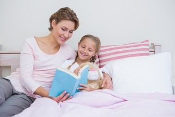 Mother with her daughter at bedtime