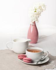 Hyacinth Flowers In Vase. Macaroon Biscuits. Cup Of Tea