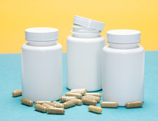 Scattered capsules with white plastic jars