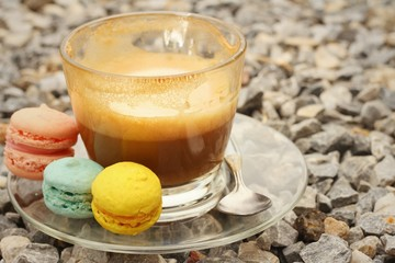 Hot coffee with macaron on the coasters.