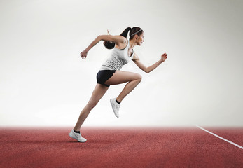 Woman running on field-track